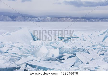 Turquoise Ice Floes. Baikal Lake Winter Landscape