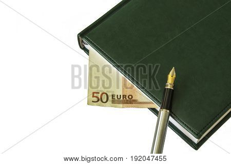 On the diary is a fountain pen. Between the sheets a bill of EUR 50 is visible