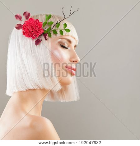 Beautiful Blonde Model Woman with Healthy Skin Bob Hairstyle and Spring Flowers. Facial Treatment and Cosmetology