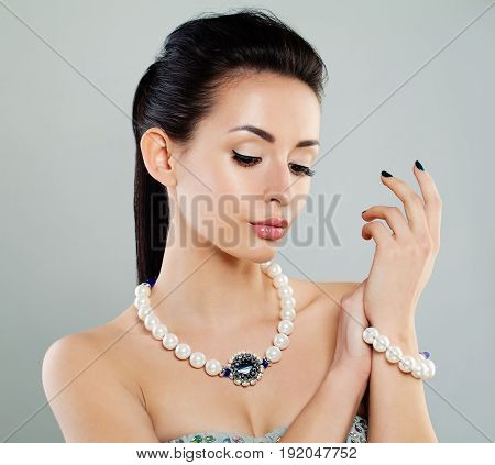 Perfect Young Fashion Model Woman with Makeup Jewelry Necklace and Bracelet