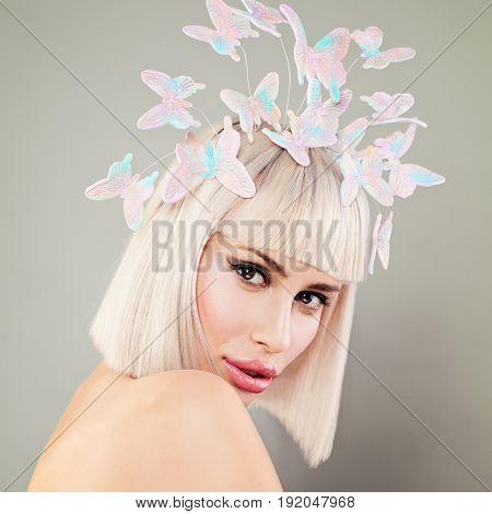 Perfect Blonde Woman with Blond Bob Hairstyle and Butterfly Hair Deco. Facial Treatment and Cosmetology
