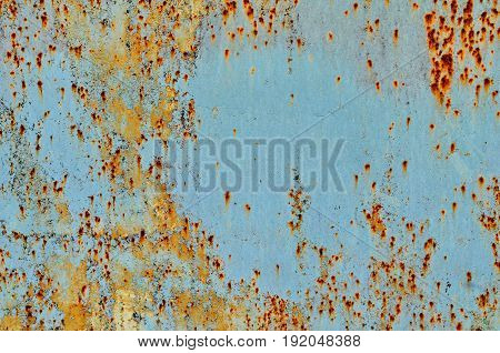 Texture of vintage painted iron wall background with many layers of paint