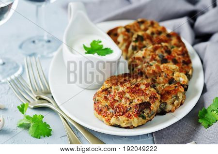 Eggplant cheese cilantro oats fritters on a grey background
