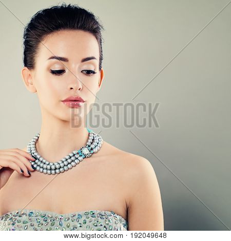 Beautiful Young Woman with Blue Pearls Necklace