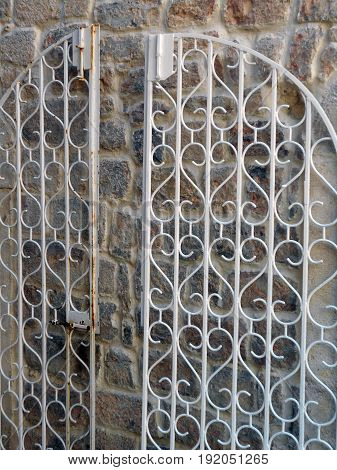 Doors that do not lead anywhere - Open wicket of protective metal grilles from two opposite doors on the same wall