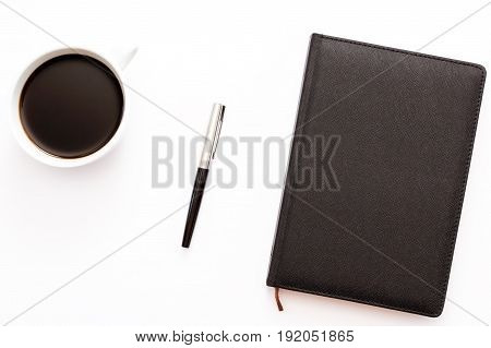 Pen, Black Diary And A Cup Of Black Coffee On A White Background. Concept Of Business Workplace.