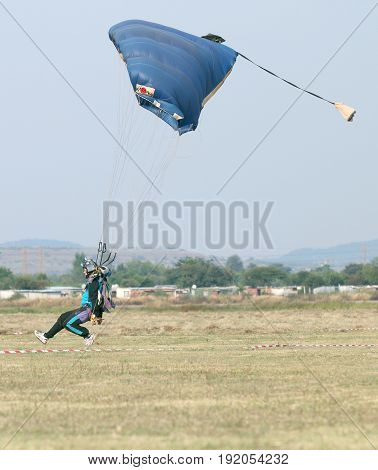 Male Skydiver Coming In For Fast Landing On Grass (landing Series Image 4 Of 4).