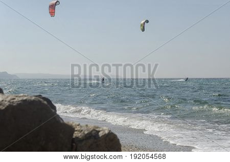 Porto Paglia Italy - October 03 2016: Seniors keeps active by practicing water sport in Sardinia