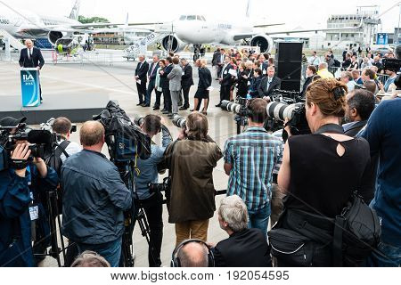 BERLIN GERMANY - JUNE 01 2016: Photographers and journalists at a press conference. Exhibition ILA Berlin Air Show 2016.