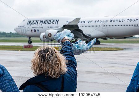 BERLIN GERMANY - JUNE 01 2016: A woman says goodbye to Iron Maiden's Boeing 747