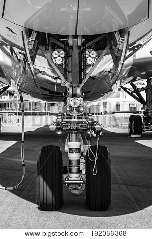 BERLIN GERMANY - JUNE 02 2016: Front landing gear of the newest airplane Airbus A350-900 XWB. Black and white. Exhibition ILA Berlin Air Show 2016
