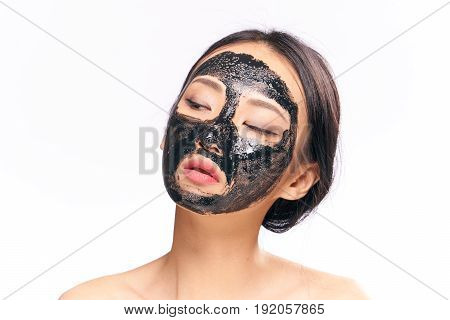 Woman in a cosmetic mask, squiggle looks after a face, skin problem, woman on an isolated background portrait.