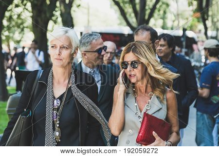 MILAN ITALY - JUNE 19: Fashionable people gather outside Armani fashion show building during Milan Men's Fashion Week on JUNE 19 2017 in Milan.