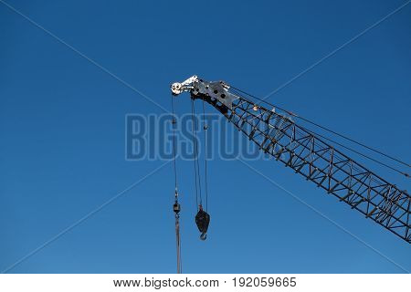 Building construction crane against blue sky in Auckland New Zealand NZ