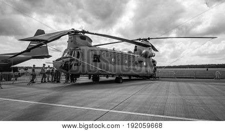 BERLIN GERMANY - JUNE 02 2016: The twin-engine tandem rotor heavy-lift helicopter Boeing CH-47 Chinook. US Army. Black and white. Exhibition ILA Berlin Air Show 2016