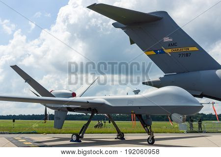 BERLIN GERMANY - JUNE 02 2016: Unmanned combat air vehicle General Atomics MQ-9 Reaper. US Air Force. Exhibition ILA Berlin Air Show 2016