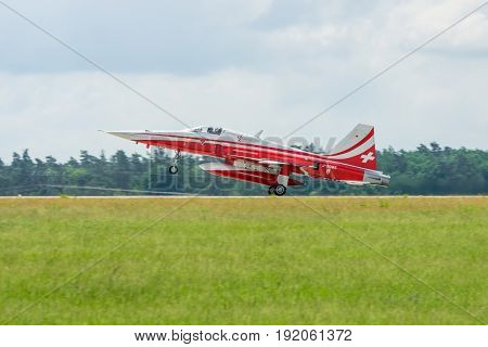 BERLIN GERMANY - JUNI 02 2016: Landing of jet Northrop F-5E Tiger II. The aerobatic team Patrouille Suisse. Exhibition ILA Berlin Air Show 2016