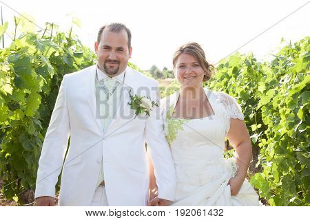 a lovely bride groom couple in vineyard
