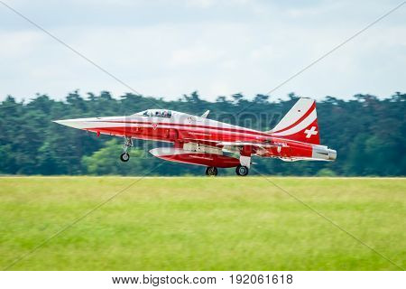 BERLIN GERMANY - JUNI 02 2016: Landing of jet Northrop F-5E Tiger II. The aerobatic team Patrouille Suisse. The pilot Captain G.Jansen. Exhibition ILA Berlin Air Show 2016