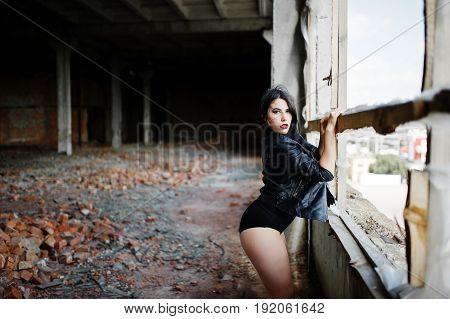 Brunette Plus Size Sexy Woman, Wear At Black Leather Jacket, Lace Panties, Bra Near Window At Abadon