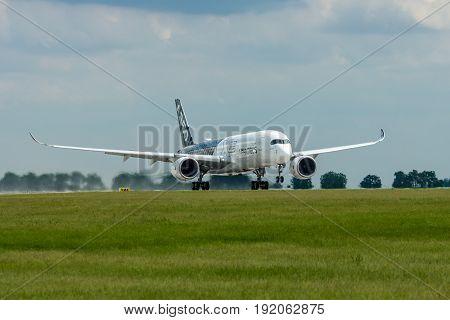 BERLIN GERMANY - JUNE 02 2016: Takeoff an aircraft Airbus A350 XWB. Exhibition ILA Berlin Air Show 2016