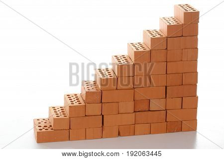 stairway with red bricks on white background