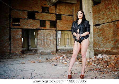 Brunette Plus Size Sexy Woman, Wear At Black Leather Jacket, Lace Panties, Bra And High Heels With C