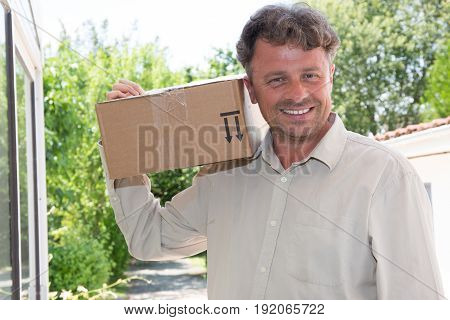 Smiling Handsome Man With Parcel For Delivery