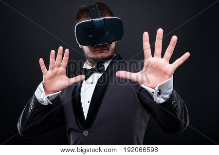 Scared Elegant Young Man With Vr Goggles
