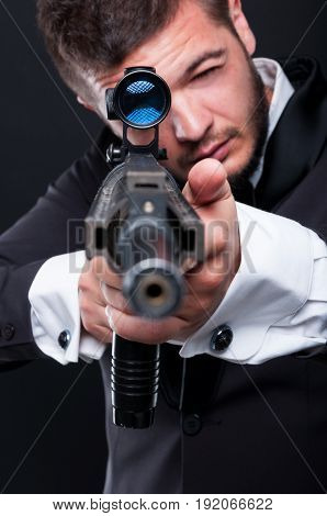 Mafia Guy Pointing At The Camera With Firearm