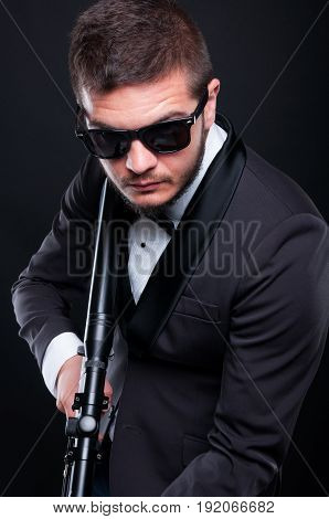 Mafia Guy With Armed Rifle Preparing To Shoot
