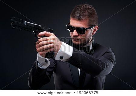 Aggressive Gunman Aiming Pistol At His Target