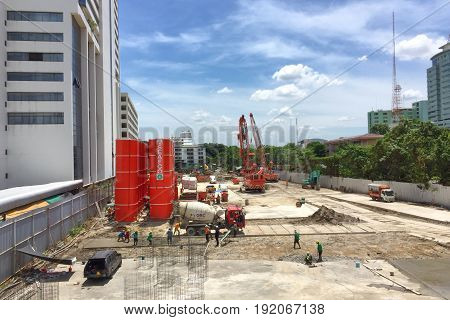 BANGKOK THAILAND 17 JUN 2017: Workers fabricating column timber formwork and reinforcement bar at the construction site near the Phayathai BTS station