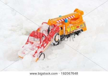 Two toys cars winter in the snow at play time