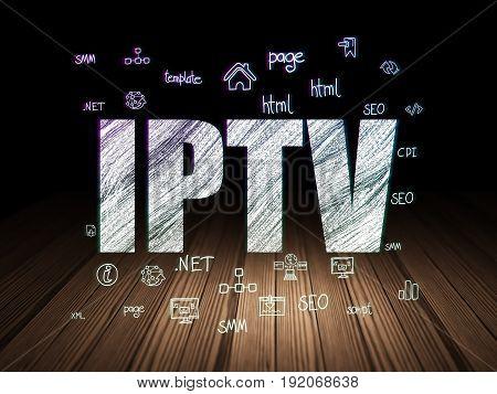Web design concept: Glowing text IPTV,  Hand Drawn Site Development Icons in grunge dark room with Wooden Floor, black background