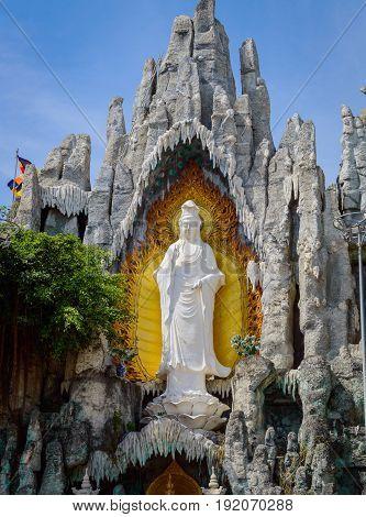 White Guan Yin Statue In The Stone