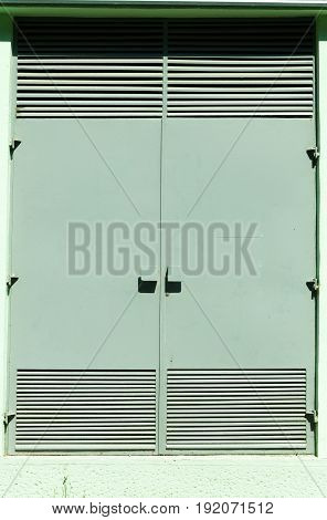 Protective metal doors of transformer station electric cabinet. Vertical.