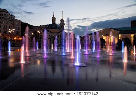 Water fountain, glows in many colors.Water, colorful fountain, evening.
