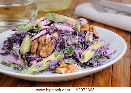 salad red coleslaw with slices of avocado apple nuts parsley dill seasoned yoghurt sauce