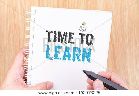Time To Learn Word On White Ring Binder Notebook With Hand Holding Pencil On Wood Table,business Con