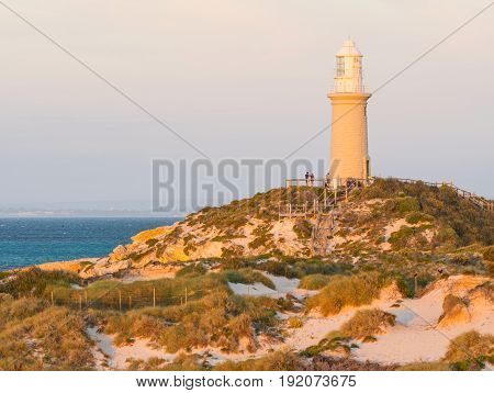 ROTTNEST ISLAND, WESTERN AUSTRALIA - APRIL 16 2017: Tourists enjoying the golden hour at Bathurst Lighthouse on Rottnest Island near Perth in Western Australia.