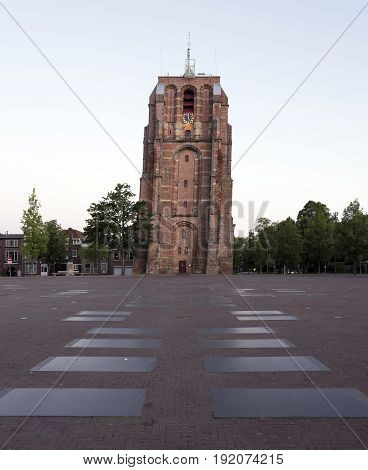 old skewed tower oldehove in capital of friesland leeuwarden in warm early morning light