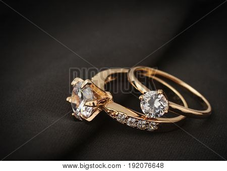 jewelry rings with diamond on black cloth