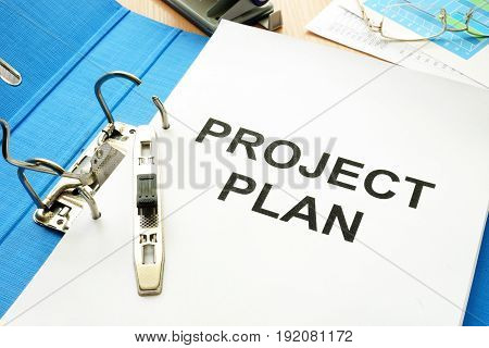 Folder and documents with title project plan.