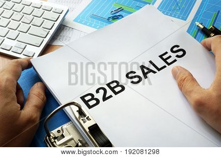 Folder and documents with title b2b sales.