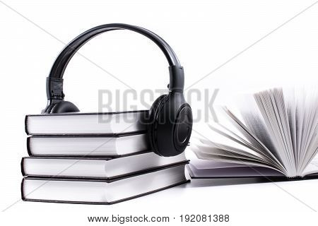 books with headphones. Audio book concept on white