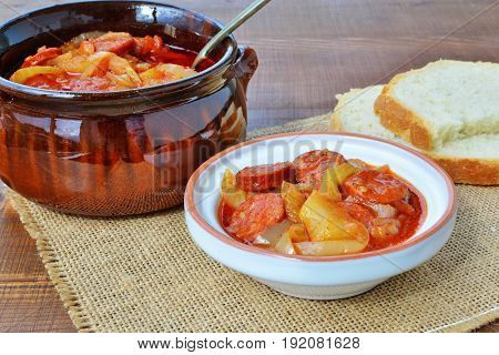 Vegetable stew lecho in bowl and ceramic pot with bread