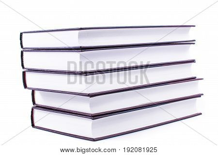 stack of books nd spectacles isolated on white