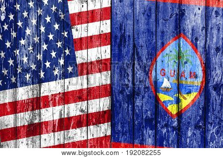 Flag of US and Guam painted on wooden frame