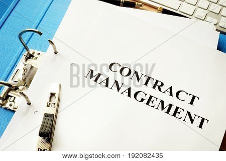 Folder and documents with title contract management.